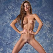 Slim Beauty Posing Nude In Erotic Studio Photo