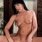 Lusty Nude Tanned Older Woman Teasing Her Pussy