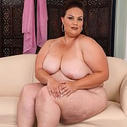 BBW Nude Sits On Sofa