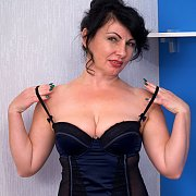 Mature Raven Hair Lady Teasing In Silky Nightie