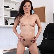 Teasing Naked Milf With Shaved Pussy