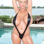 Black Sling Swimsuit On A Huge Tits Mature Woman