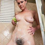 Woman Washing Her Bushy Pussy