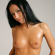 Nude Black Haired Beauty Oiled Down