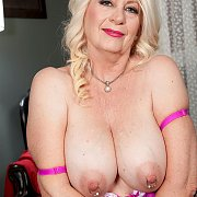 Naughty Mature Lady Showing Her Pierced Nipples