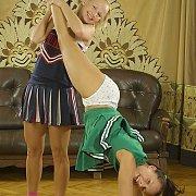 Playful Coed Teen Cheerleader Practicing Their Routine