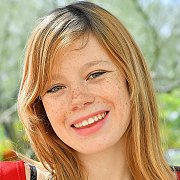 Smiling Freckled Redhead Girl Outside