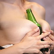 Banging Herself With A Bottle