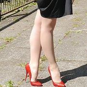 Red Stiletto Heels On Pantyhose Legs