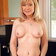 Lusty Mature Blonde Topless In Kitchen