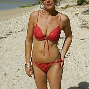 Bikini Milf On The Beach During A Vacation