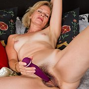 Mature Lady With Tan Lines Using Her Vibrator