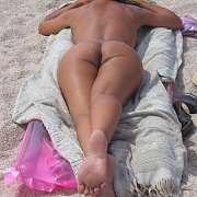 Tanning Nude Amateur Woman Laying Out