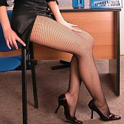 Net Nylons Office Teaser With Lusty Legs