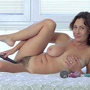 Pretty Busty Milf Pleasing Her Hairy Pussy