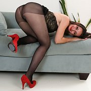 Red Heels And Black Nylons On A Bent Over Milf
