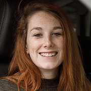 Smiling Redhead With Freckles In A Car