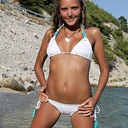 White Bikini Wearing Mango Outdoors