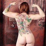 Tattooed Steampunk Redhead