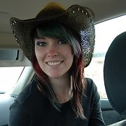Amateur Cowgirl In A Car