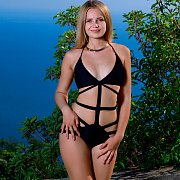 Young Erotic Model Strips Swimsuit