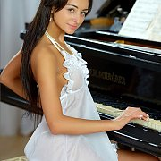 Pretty Young Lady In Lingerie Behind The Piano