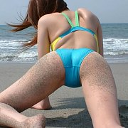 Sandy Ass Asian Swimsuit Girl Crawling At Beach
