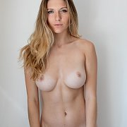 Blonde Tan Lines Model Posing Against A Wall