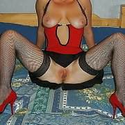 Black Fishnets And Red Heels Pussy Flasher