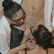 Two Brunettes In Glasses And Stockings Office Threesome