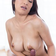 Busty Asian Babe Stroking On His Erection
