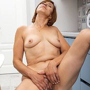 Mature Masturbation In The Kitchen