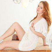 Beautiful Redhead Strips Nude
