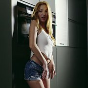 Aroused Freckles Redhead Masturbates By The Oven